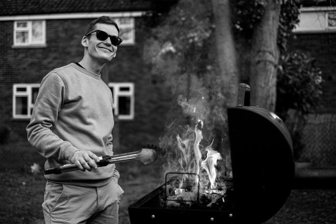 Joel cooking at a BBQ