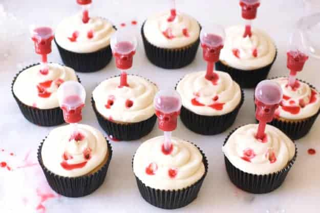 Vampire Bite Cupcakes with Edible Blood | easy halloween recipes, halloween dessert recipes, halloween treat recipes, halloween cupcake recipes, fun halloween recipes, vampire recipe ideas, spooky halloween treats, kid-friendly halloween treats, homemade halloween recipes || The Butter Half #vampirecupcakes #halloweencupcakes #halloweendesserts #thebutterhalf