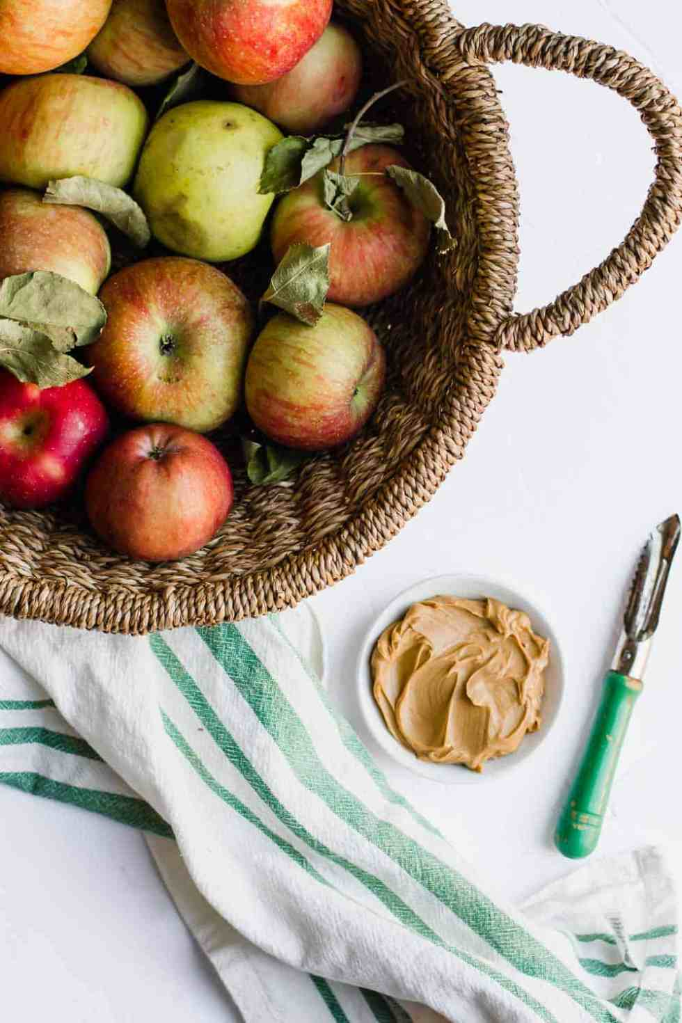 Make this apple and peanut butter sandwich as an easy and healthy snack. Naturally gluten-free and vegan, this can also be made nut-free. Whip this together in under 5 minutes for a snack the whole family will love. || The Butter Half #easysnacks #easysnackidea #healthysnacks #glutenfreesnacks #vegansnacks #quicksnacks #thebutterhalf