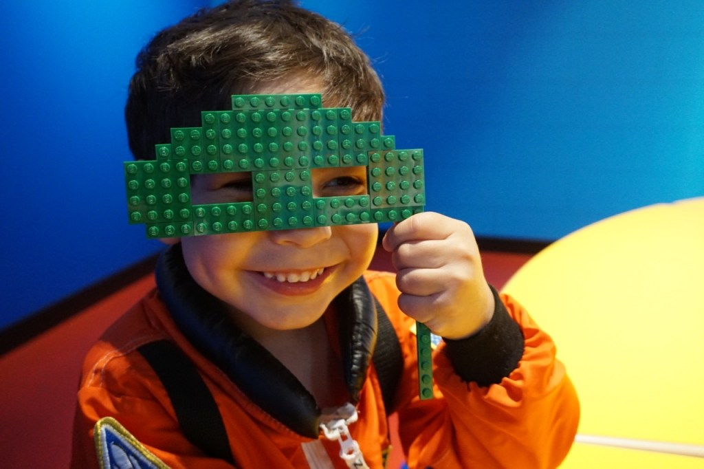 One of the activities at Brick or Treat is creating a mask out of LEGOS.