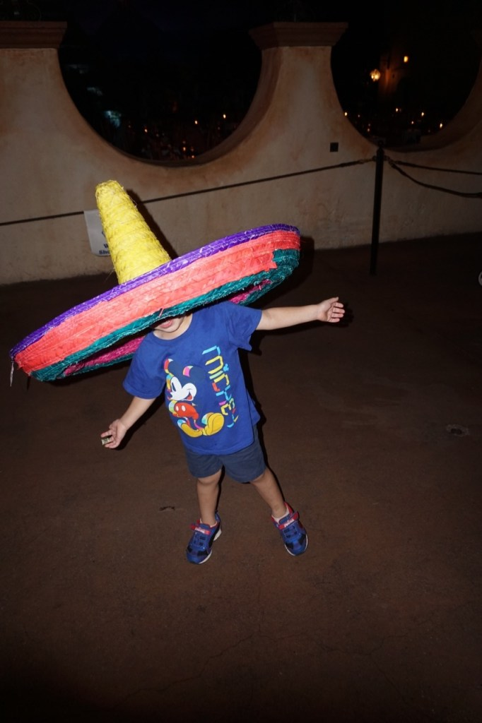 My son loved the Gran Fiesta ride at Epcot and tried on a sombrero!