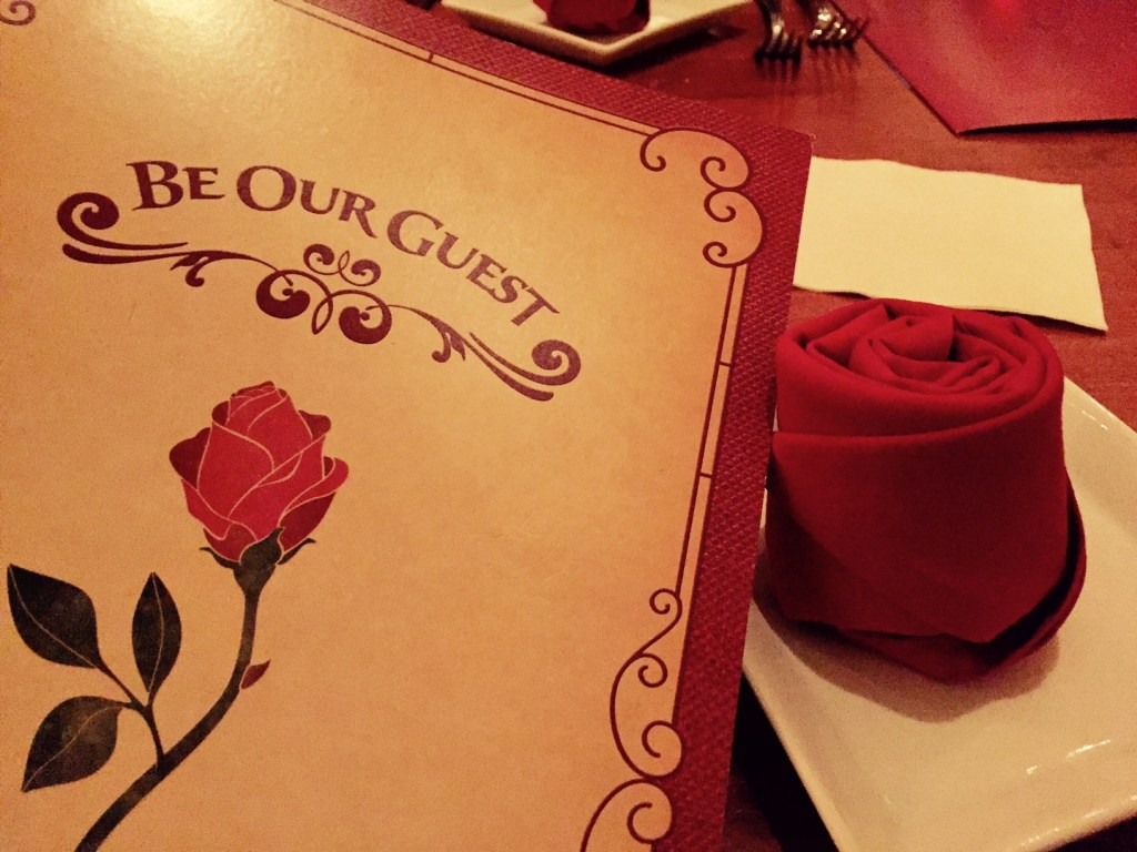 Napkins in the shape of red roses? Yes, please! The ambiance is one of the reasons to eat dinner at Be Our Guest.