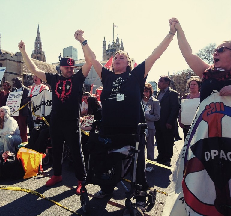 DPAC activists linked arms in solidarity