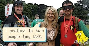 """Esther McVey standing with two men dressed as Batman and Robin. She's saying: """"I pretend to help people too, lads"""""""
