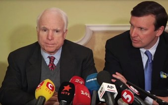 Republican McCain sits with Democrat Chris Murphy at a press conference in Kiev, Ukraine