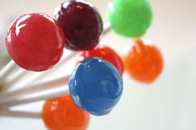 Weed lollipops recipe with the candy in red, purple, blue, green and orange.