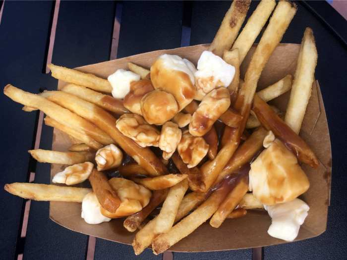 Overhead shot of weed poutine poutine has lots of gravy and cheese curds on it