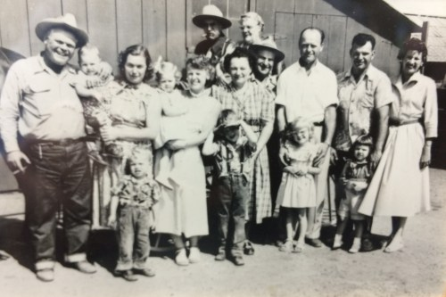 The Vermeulen's on their family farm in the early 1950s. Virginia Vermeulen Germann is the child pictured second from the right with her father, Charles, standing behind her. Photo: Courtesy of Virginia Vermeulen Germann