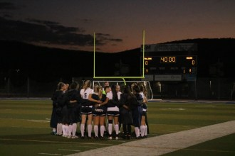 San Juan Hills huddles just before the start of the second half against Huntington Beach in a CIF-SS Division 1 first-round match on Feb. 15. Photo: Zach Cavanagh