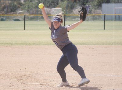 San Juan Hills' Phoebe Popplewell winds up to throw a pitch against Trabuco Hills on Thursday, April 19. Photo: Zach Cavanagh