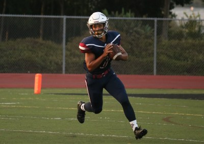 Junior quarterback Tyler Henry steps up in place of the ailing starter and earned a win in CVC's opener. Photo: Zach Cavanagh.