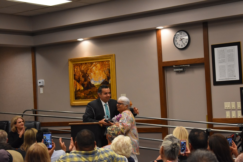 Martha Orozco, a longtime educator in the region, receives the Educator of the Year Award from Mayor Sergio Farias during the Oct. 16 city council meeting. Photo: Alex Groves