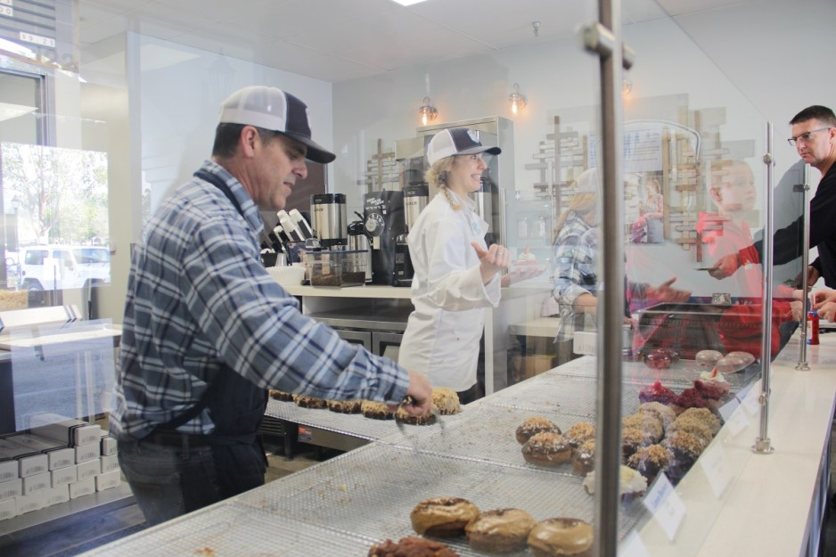 Dave Rhode, co-owner of JD Flannel Donuts and Coffee, puts out a fresh batch of crumble cake donuts on Friday, Feb. 15. Photo: Shawn Raymundo