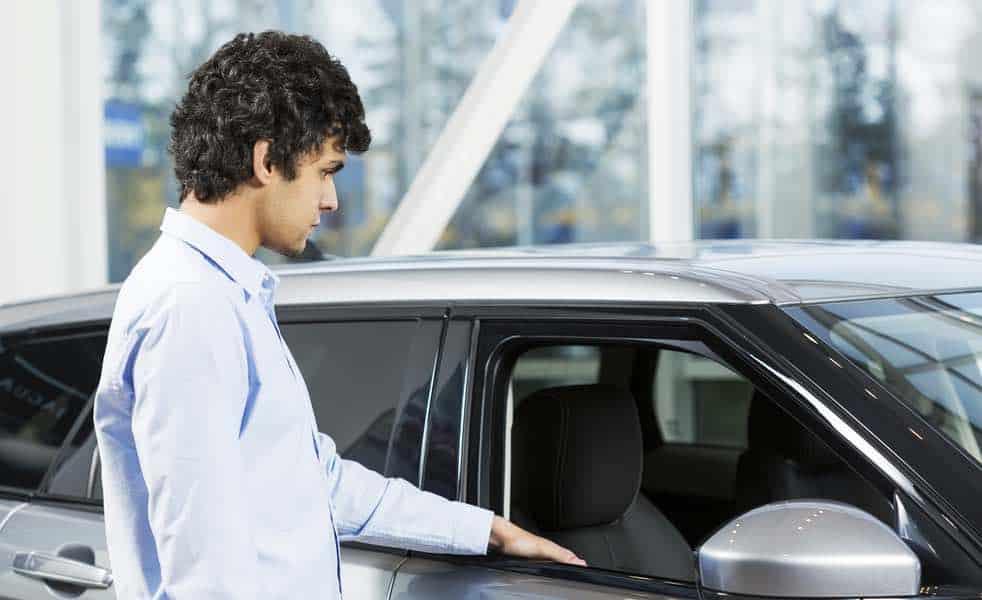 Car buyer in car dealer showroom