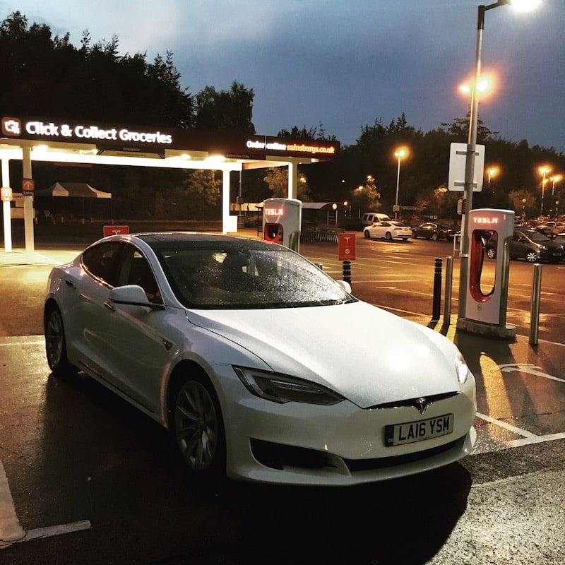 Tesla Model S from White Car on charge at a Supercharger station
