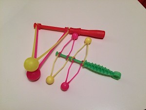 10 physics toys use novelty toys for STEM experiments. Tops, rainbow glasses, and clacking toys help kids learn STEM concepts.