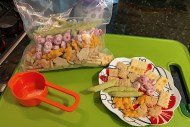 Make a toddler snack mix to help keep little tummies satisfied. A mixture of treats give little ones practice with fine motor skills.