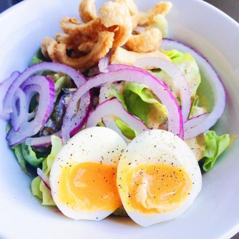 Spicy, Crunchy Protein Salad! Yes please! Butter lettuce ️tossed in spicy cashew dressing, topped with red onion, a 6 minute egg & pork cracklings!  So if you can't find good pork cracklings make you own. Seriously not hard! Buy pork belly. Carefully remove skin, cut in to strips, salt- set aside. Remove fat. In heavy bottomed pot, render fat. Cook skin in fat. Done!  I'm Cuban, there is a special place in my heart for chicharrones. Seriously. ♥️ This salad was all that and better than a bag of chips!  #glutenfree #grainfree #sugarfree #dairyfree #paleo #pork #eggporn #salads #healthyfoodporn #castawaykitchen #tastespotting #feedfeed