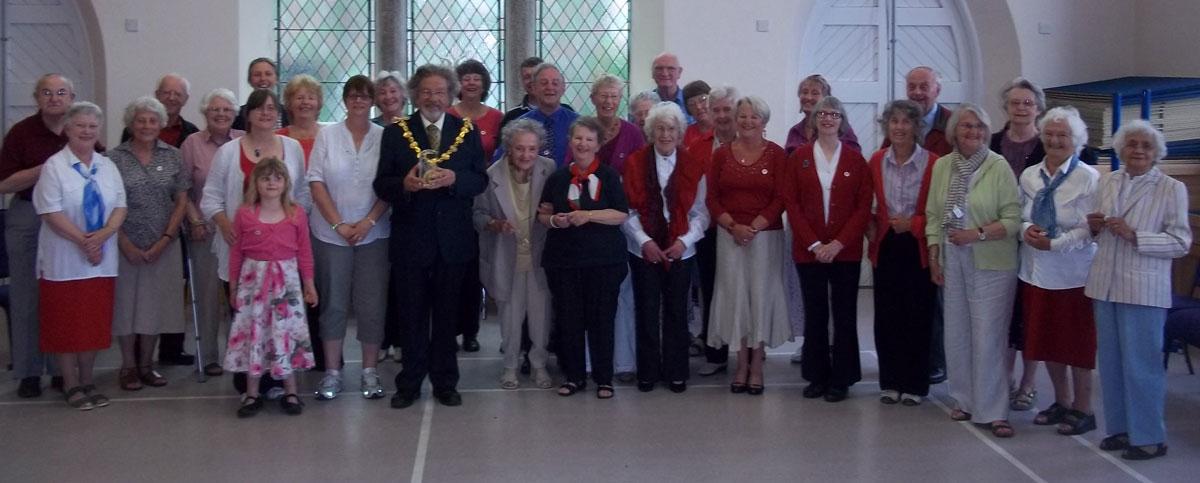 Volunteers-being-presented-with-QAVS-lapel-badge-by-Mayor-of-Penzance-June-2012
