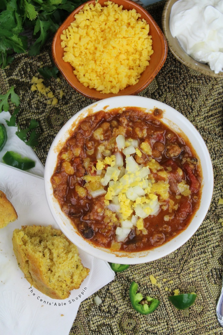 This hearty, 15-bean Instant Pot Chili is perfect to make for a family or a crowd. Serve up with all of your favorite toppings as is, or dumped over rice for a change of pace. #InstantPot #15Bean #Chili #PressureCooker