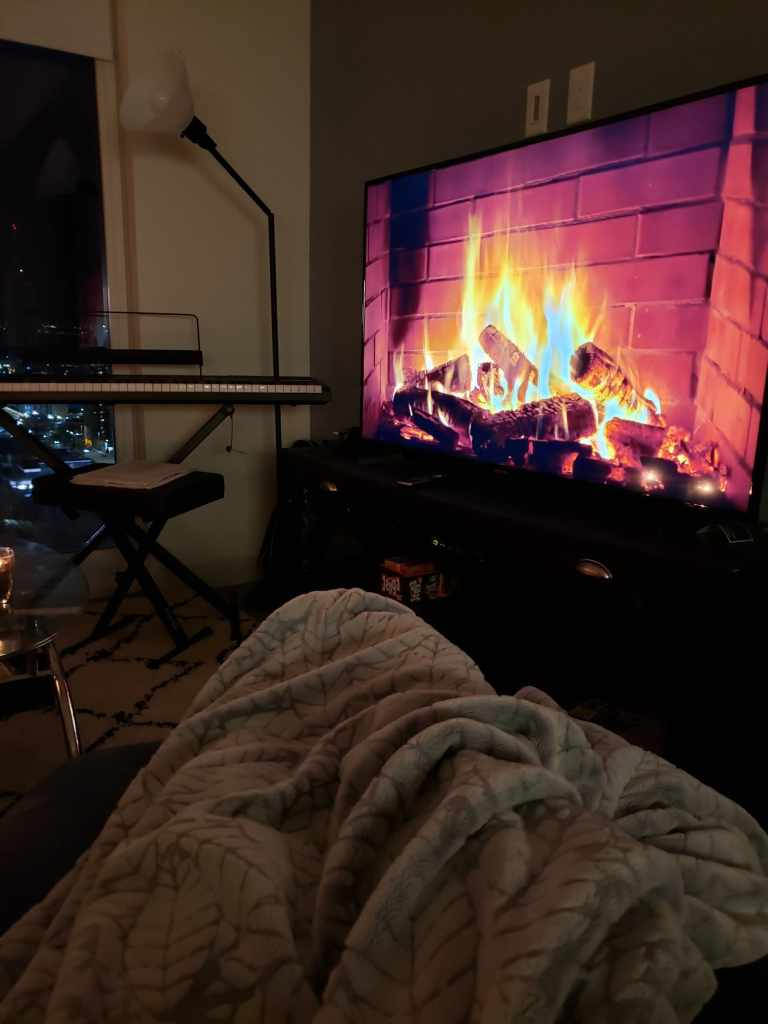 Cozy setting in front of a TV fireplace