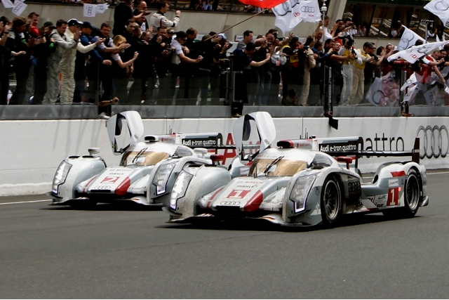 Andre Lotterer leads the Audi formation finish across the line after 24 hours (Photo Credit: Audi Motorsport)