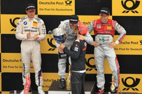 Gary receives his trophy at Brands last year from fellow McLaren stablemate Button (Image credit: Octane Photographic)