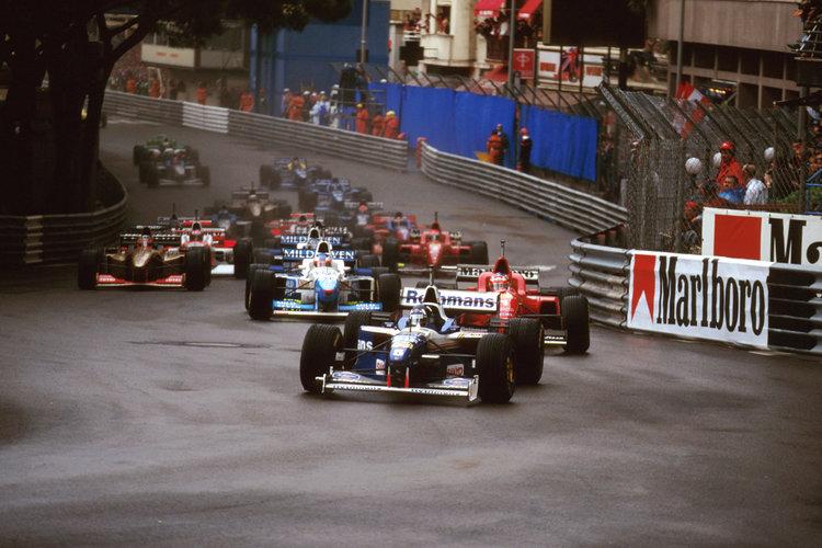 1996 Monaco Grand Prix. Monte Carlo, Monaco. 16-19 May 1996. Damon Hill (Williams FW18 Renault) leads Michael Schumacher (Ferrari F310) into Ste. Devote at the start. Ref-96 MON 07. World Copyright - LAT Photographic