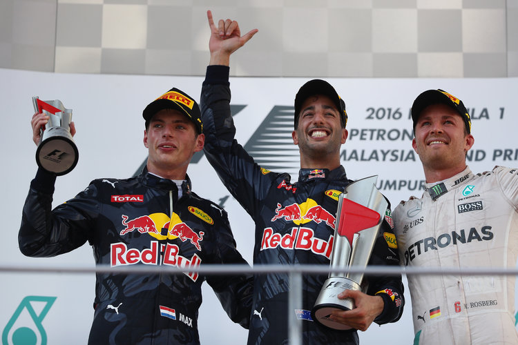 KUALA LUMPUR, MALAYSIA - OCTOBER 02:  Daniel Ricciardo of Australia and Red Bull Racing, Max Verstappen of Netherlands and Red Bull Racing and Nico Rosberg of Germany and Mercedes GP on the podium during the Malaysia Formula One Grand Prix at Sepang Circuit on October 2, 2016 in Kuala Lumpur, Malaysia.  (Photo by Clive Mason/Getty Images). Credit: Red Bull Content Pool