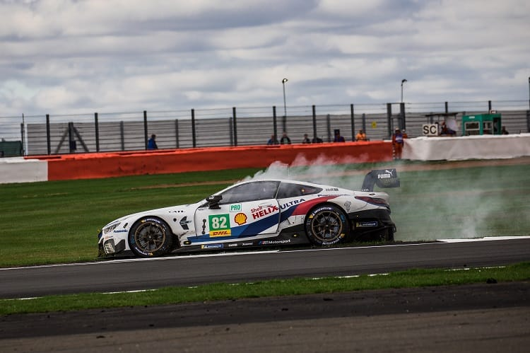The #82 BMW Team MTEK in its race-ending spin at Maggotts
