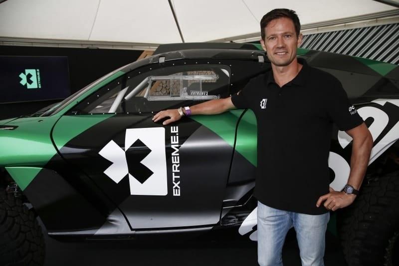 Sebastien Ogier standing next to the Extreme E car