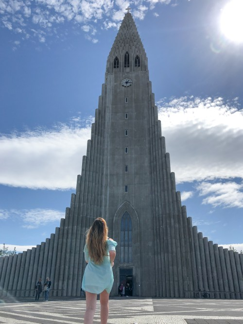 towering church and girl in blue dress