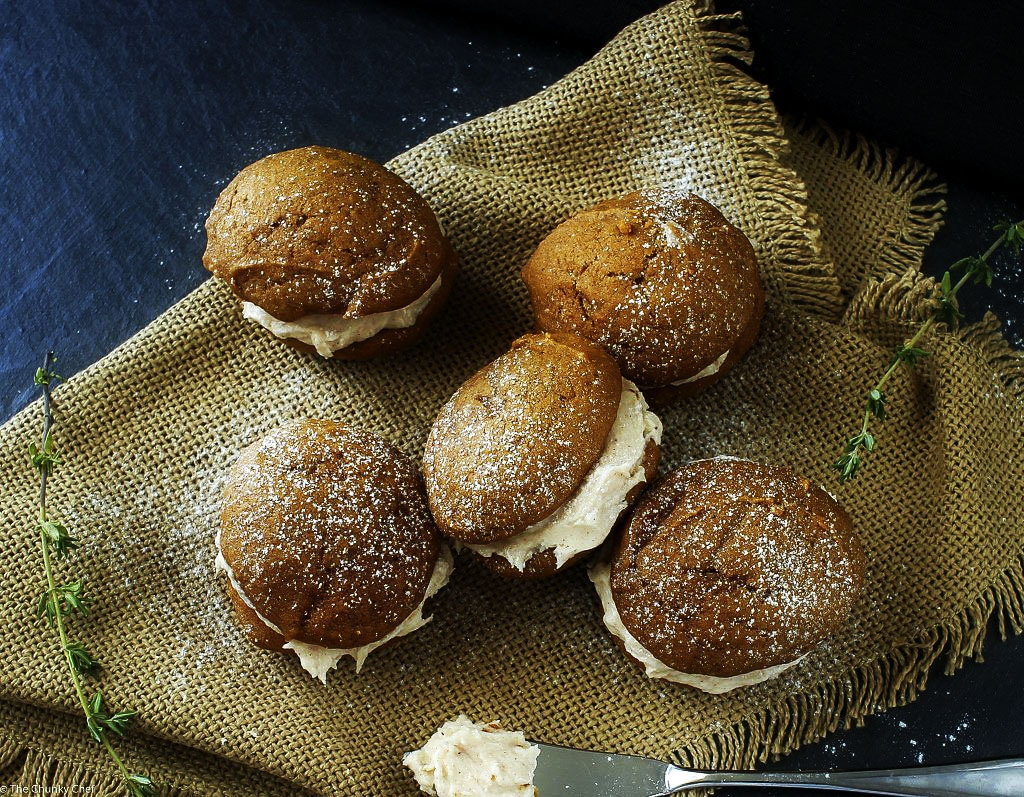 Spiced Pumpkin Whoopie Pies   The Chunky Chef   Soft and light spiced pumpkin cookies sandwiched together with a decadent, yet easy to make, browned butter maple cinnamon frosting!