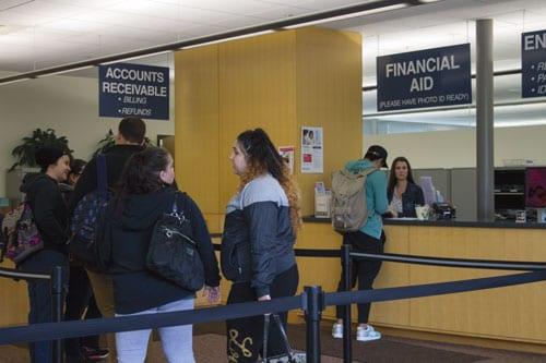 Students wait in line to discuss and get help with their financial aid.