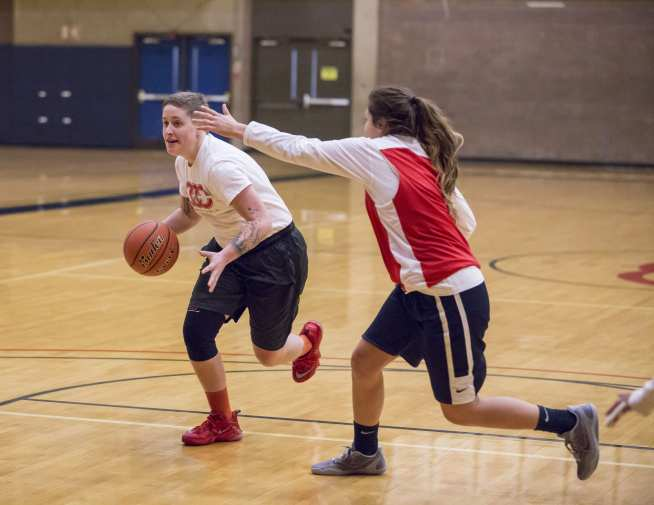 Lexi Pittman drives to the hoop against Rachel Johnny.
