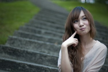 9382-a-beautiful-chinese-girl-sitting-on-steps-making-a-silly-face-pv