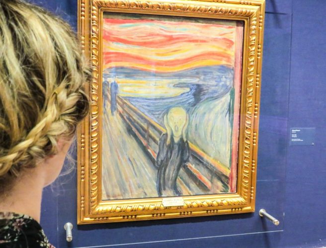 48 Hours in Oslo Girl with braid looking at Scream by Edvard Munch in Oslo Norway