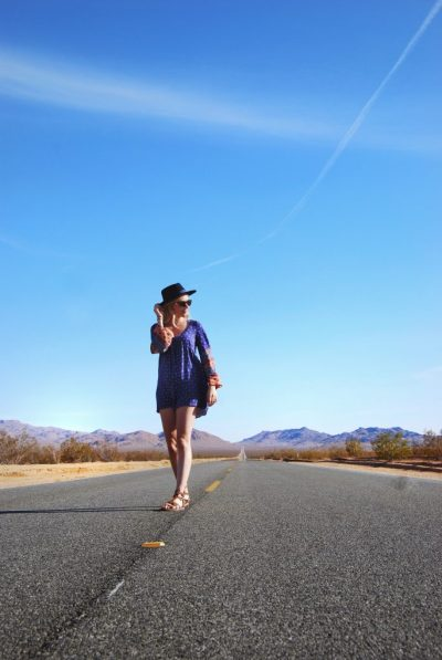 epic road trip to Las Vegas from Los Angeles; girl boho walking road