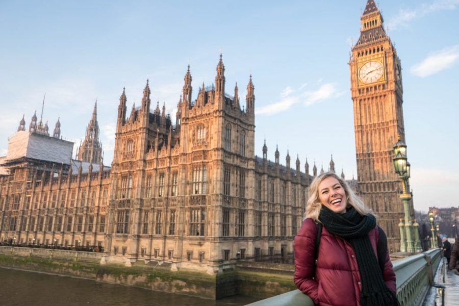 I'm Still The Clumsiest Traveler Ever; blonde girl laughing in front of Big Ben and Parliament London England