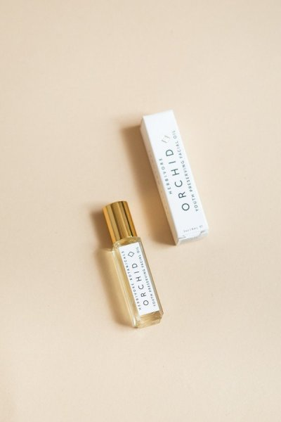 winter beauty products; Orchid Facial Roller Herbivore Botanicals Flat Lay