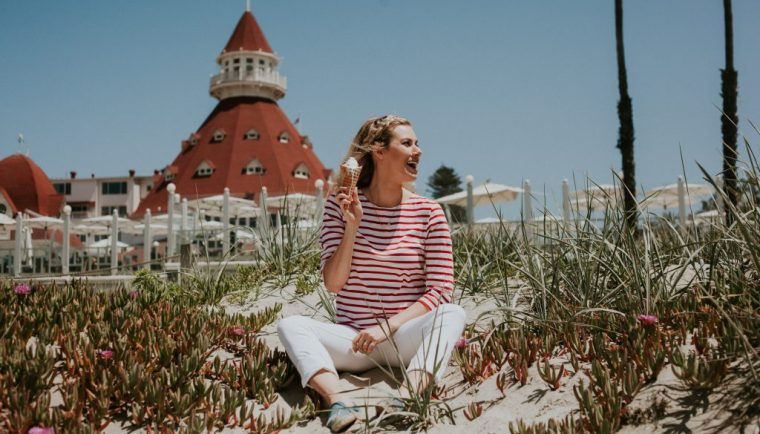 Perfect Stay at Hotel Del Coronado; girl sitting on beach with ice cream