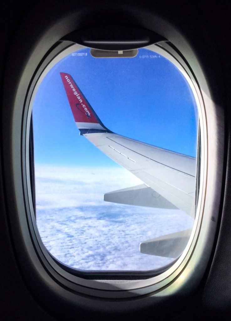 travel and reduce your carbon footprint; airplane view wing