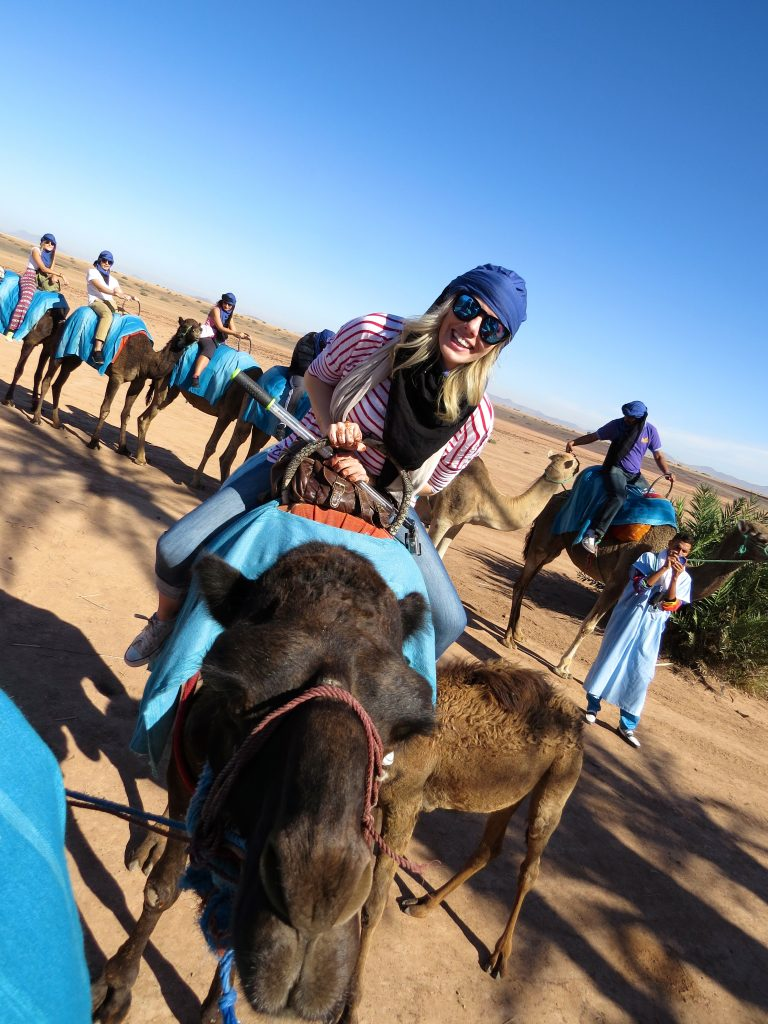 travel and reduce your carbon footprint; girl on camel