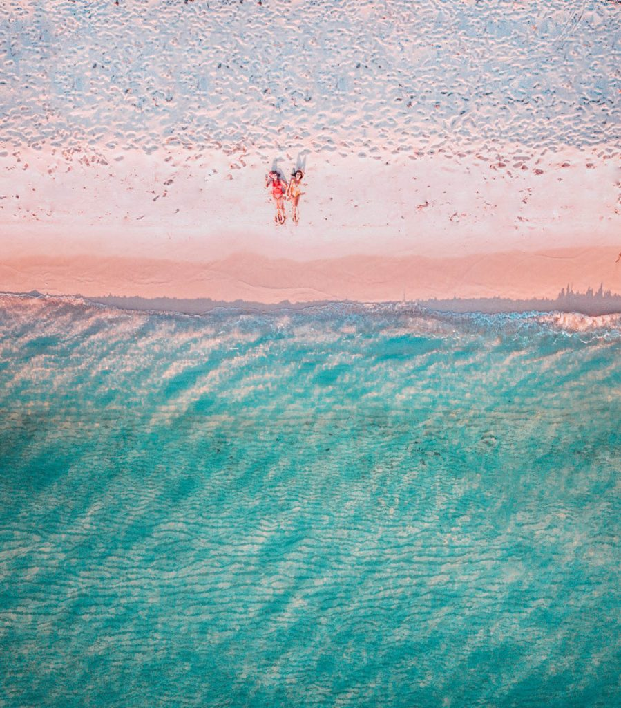 southwest Dominican Republic; girls laying on the beach; aerial drone shot of Bahia de las Aguilas