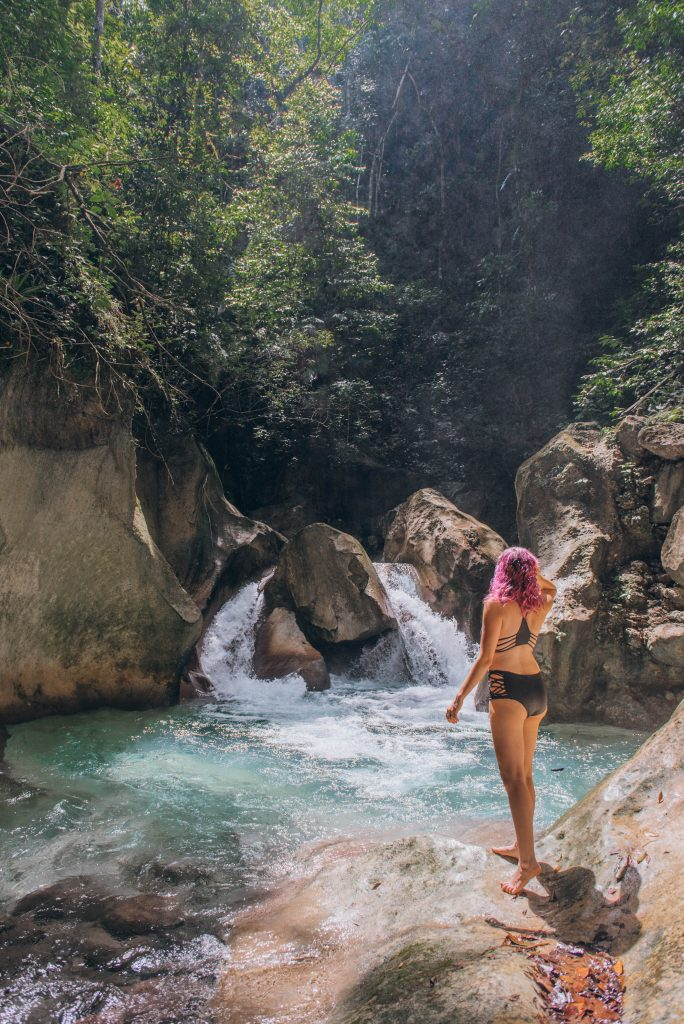 southwest Dominican Republic; girls looking out over the waterfall; purple hair; view of La Plaza