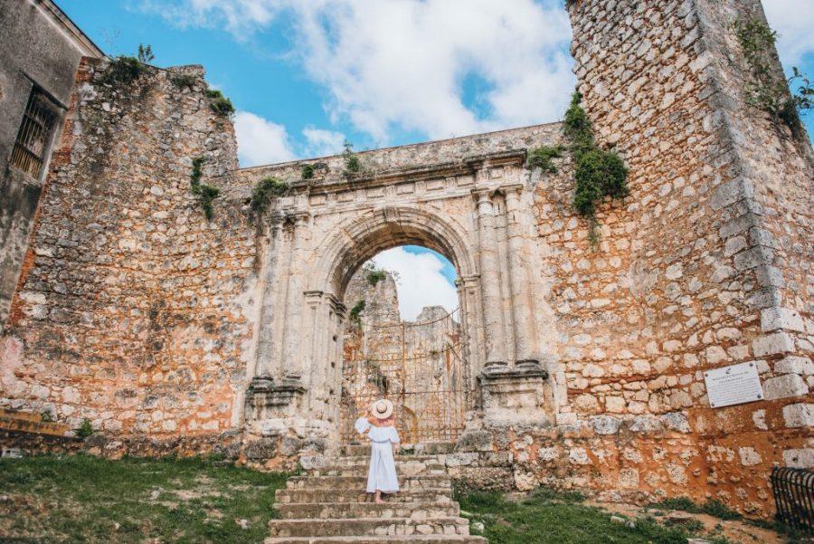 24 Hours in Santo Domingo; girl walking in front of monaterio