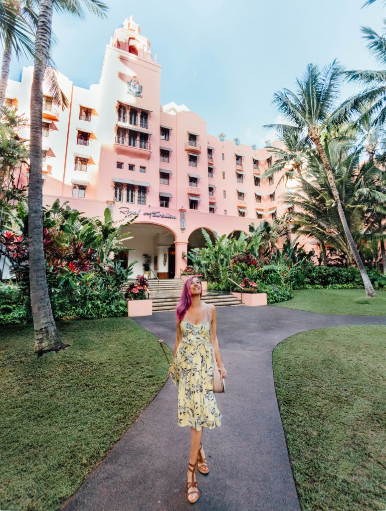 2017 was the best; girl walking in yellow dress in front of Royal Hawaiian Hotel on Oahu