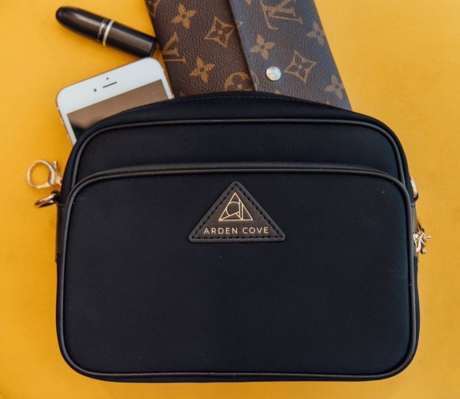best anti theft purse; The Clumsy Traveler with black Arden Cove cross body bag close up