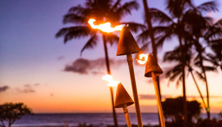best things to do in Oahu; sunset and tiki torches in Hawaii luau