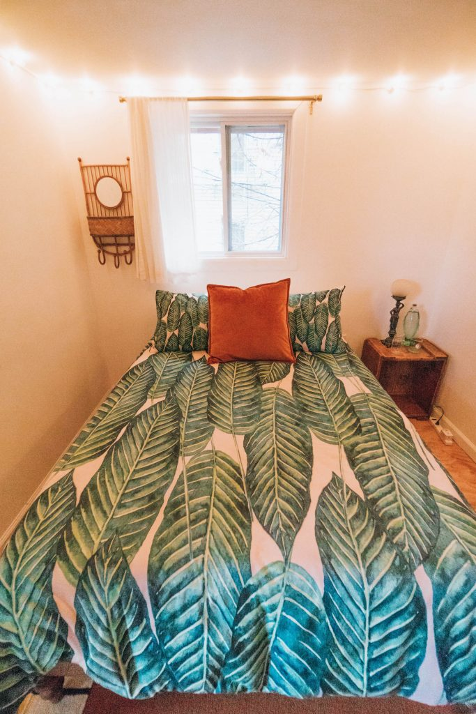 Staying at The Funky Loft in Brooklyn, New York; interior retro apartment tropical room
